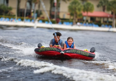 Two guests tubing on a lake at Orange Lake Resort near Orlando, Florida