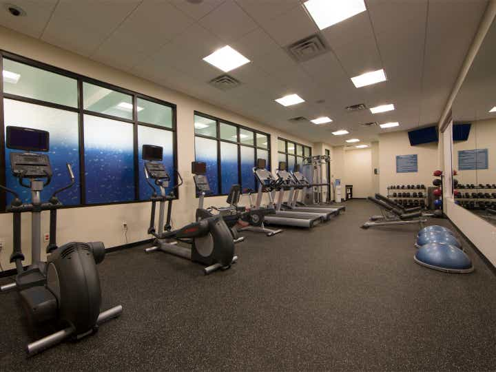 Fitness center with weights, treadmills and ellipticals at Williamsburg Resort.