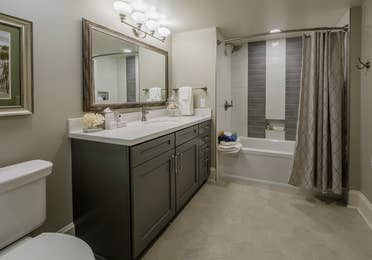 A bathroom with a standard shower and bathtub in a four-bedroom Signature Collection villa at Cape Canaveral Resort