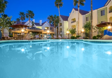 Evening views of the pool at Desert Club Resort in Las Vegas