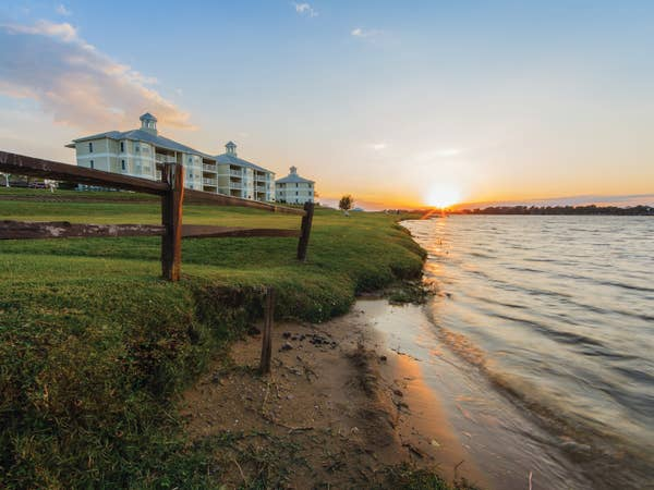 View of lake and property buildings at Piney Shores Resort in Texas.