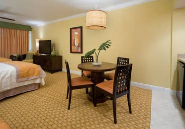 Small dining area with four chairs in a studio room in West Village at Orange Lake Resort near Orlando, FL
