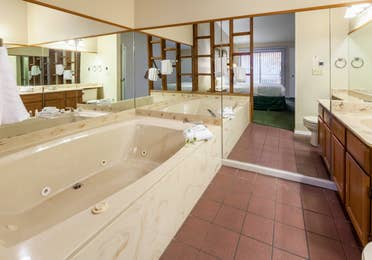 Master bathroom with whirlpool tub in a two-bedroom cabin at Ozark Mountain Resort in Kimberling City, Missouri