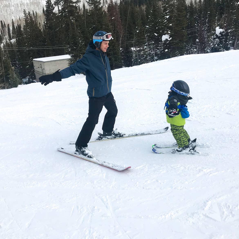 Featured Contributor, Jessica Averett's husband teaches Emmett the fundamentals of skiing.