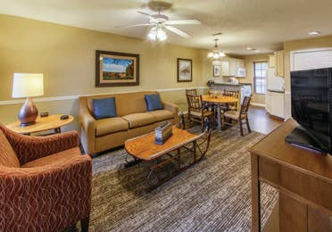 Family room with a view of the kitchen in a two bedroom villa at Oak n' Spruce Resort in South Lee, Massachusetts