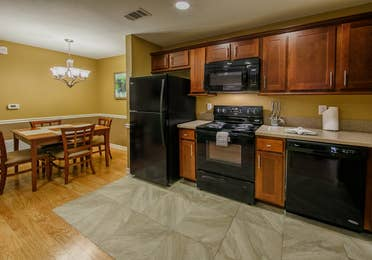 A large kitchen with a dining area in a one-bedroom ambassador villa at the Hill Country Resort in Canyon Lake, Texas.