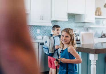 Two young kids in a kitchen in a villa