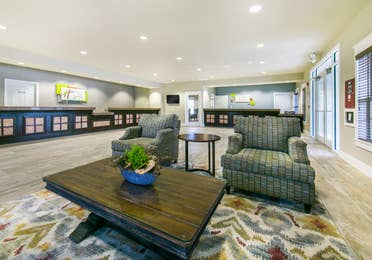 Lobby with comfortable seating and front desk at Fox River Resort in Sheridan, Illinois