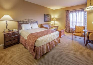 One queen bed and a sleeper sofa in a studio room at David Walley's Resort in Genoa, Nevada