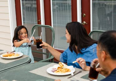 Family eating outdoors at Holiday Hills Resort in Branson, Missouri.