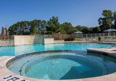Outdoor round hot tub at Villages Resort in Flint, Texas