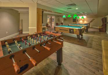 A foosball and two billiard tables in Sidewinders Arcade at Mount Ascutney Resort in Brownsville, VT