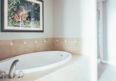 Bathroom with soaking tub in a villa in River Island at Orange Lake Resort near Orlando, Florida
