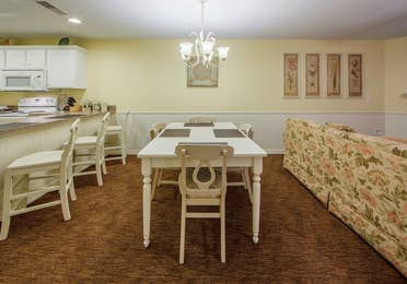 Dining room table with four chairs in a Presidential two-bedroom villa at Ozark Mountain Resort in Kimberling City, Missouri