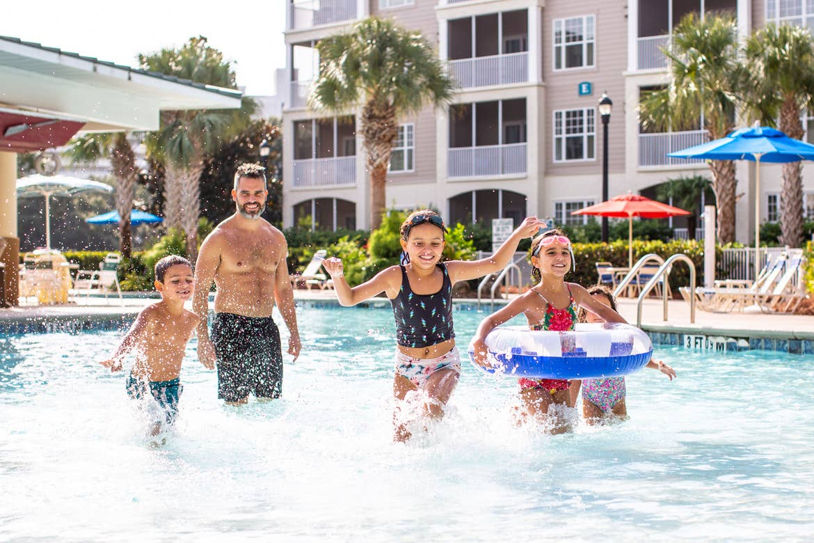 Brenda's family exits the pool with a big splash outside of the South Beach Resort.