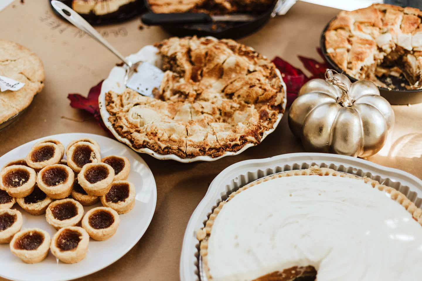 A festive fall table adorned with various pastries and desserts.