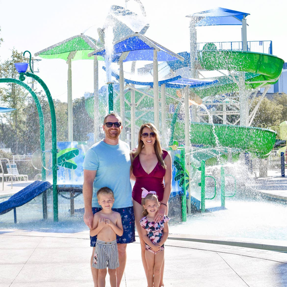 Featured Contributor, Brianna Steele (top right) stands with her family near the splash pad of our South Beach resort in Myrtle Beach, SC.