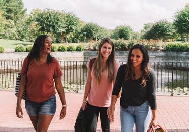 Three women checking into resort.