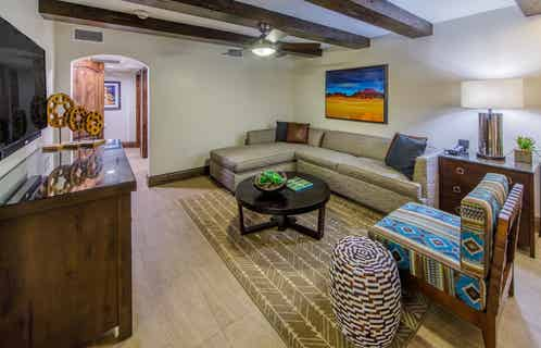 Living room with sectional sofa and southwestern style decor in a Two-Bedroom Signature Collection villa at Scottsdale Resort in Arizona