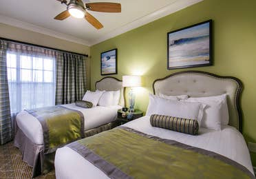 Bedroom with two beds in a three-bedroom Signature Collection villa at South Beach Resort in Myrtle Beach, South Carolina.