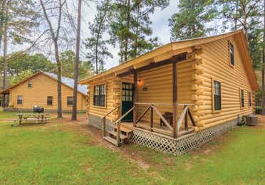 View of two cabin properties at the Lake O' the Wood Resort in Flint Texas.