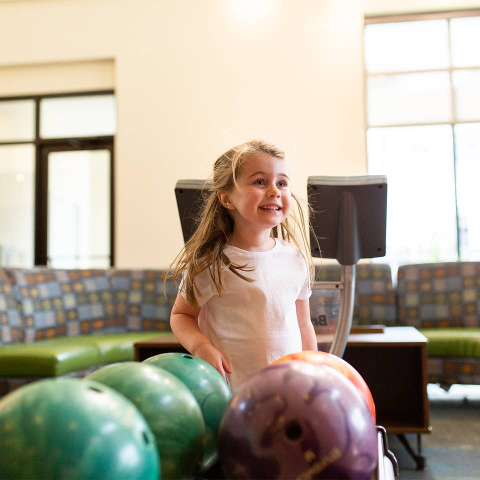 Young child bowling at Williamsburg Resort.