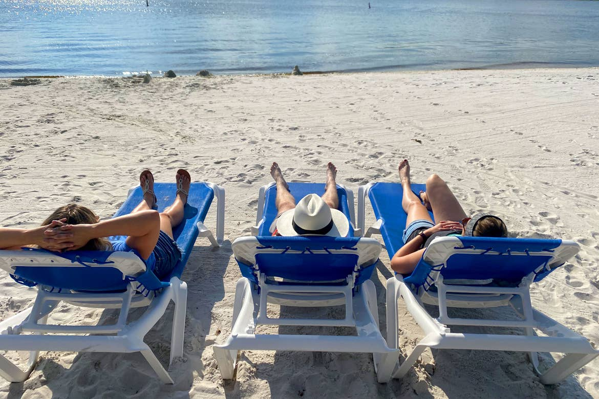 Featured Contributor, Angie Orth's three friends pose on the sands at our Orange Lake resort in Orlando, Florida.