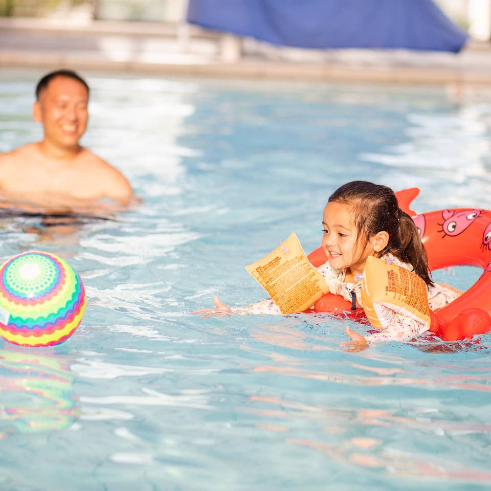 Family playing in pool at Holiday Hills Resort in Branson, Missouri.