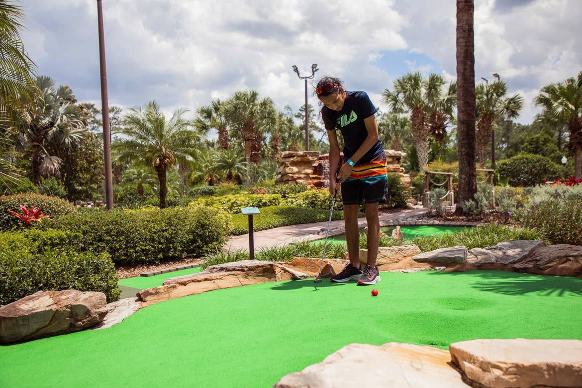 Special Olympic Athlete, Roan Luallen plays a round of mini golf at our Orange Lake Resort located in Orlando, Florida.