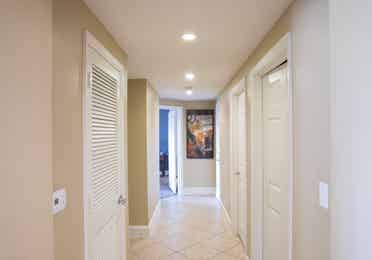 Hallway leading to bedrooms in a four bedroom Signature villa in River Island at Orange Lake Resort near Orlando, Florida