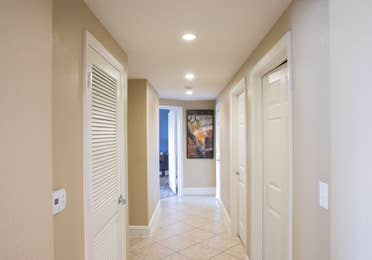 Hallway leading to bedrooms in a four bedroom Signature villa in River Island at Orange Lake Resort near Orlando, Florida