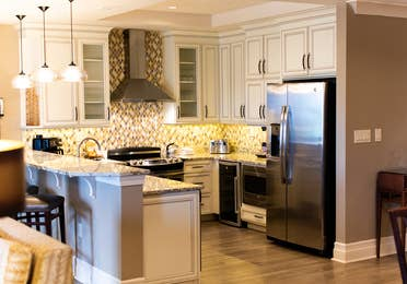 Full kitchen with stainless steel appliances in a four-bedroom Signature Collection villa at South Beach Resort in Myrtle Beach, South Carolina.