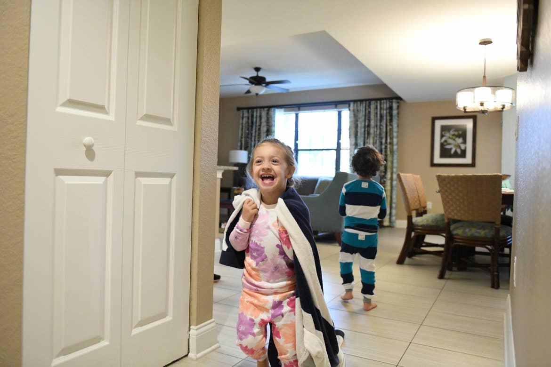 Lola wearing a towel like a cape