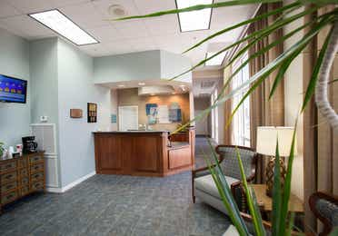 Lobby with reception desk, comfortable seating, and a flat screen TV at Panama City Beach Resort