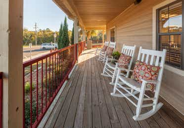 Porch with rocking chairs at Piney Shores Resort in Conroe, Texas