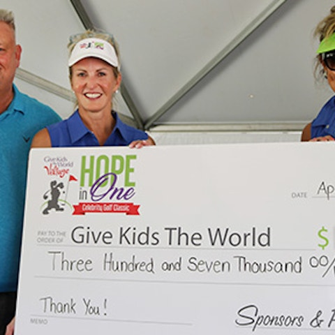 John Sutherland, Vice President of Sales at Holiday Inn Club Vacations Incorporated, presenting a large check to Give Kids the World for $307,000