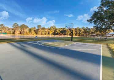 Outdoor basketball court at Piney Shores Resort in Conroe, Texas.