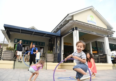 Children hula-hooping outside of Breezes Restaurant at Orange Lake Resort near Orlando, Florida