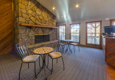 Lobby with seating area and stone fireplace at Ozark Mountain Resort in Kimberling City, Missouri
