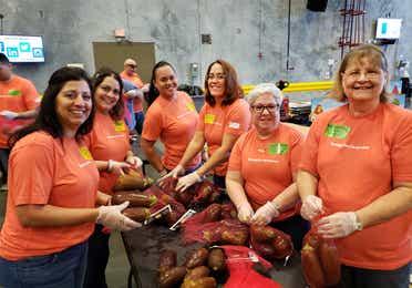 A group of volunteers sorting food at Second Harvest Food Bank in Orlando, FL