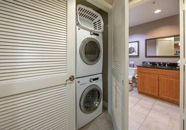 In-unit washer and dryer outside of a bathroom in a three-bedroom villa at Sunset Cove Resort in Marco Island, Florida