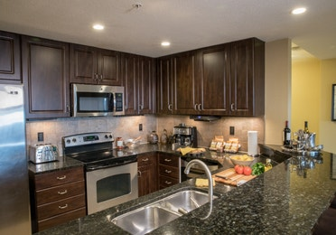 Full kitchen with stainless steel appliances in a four bedroom Signature villa in River Island at Orange Lake Resort near Orlando, Florida