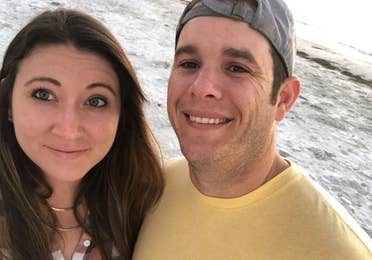 Featured contributor and Checking In editor, Tori Ferrante (left), and her husband, Brooks (right) stand on a beach in Cape Canaveral, Florida.