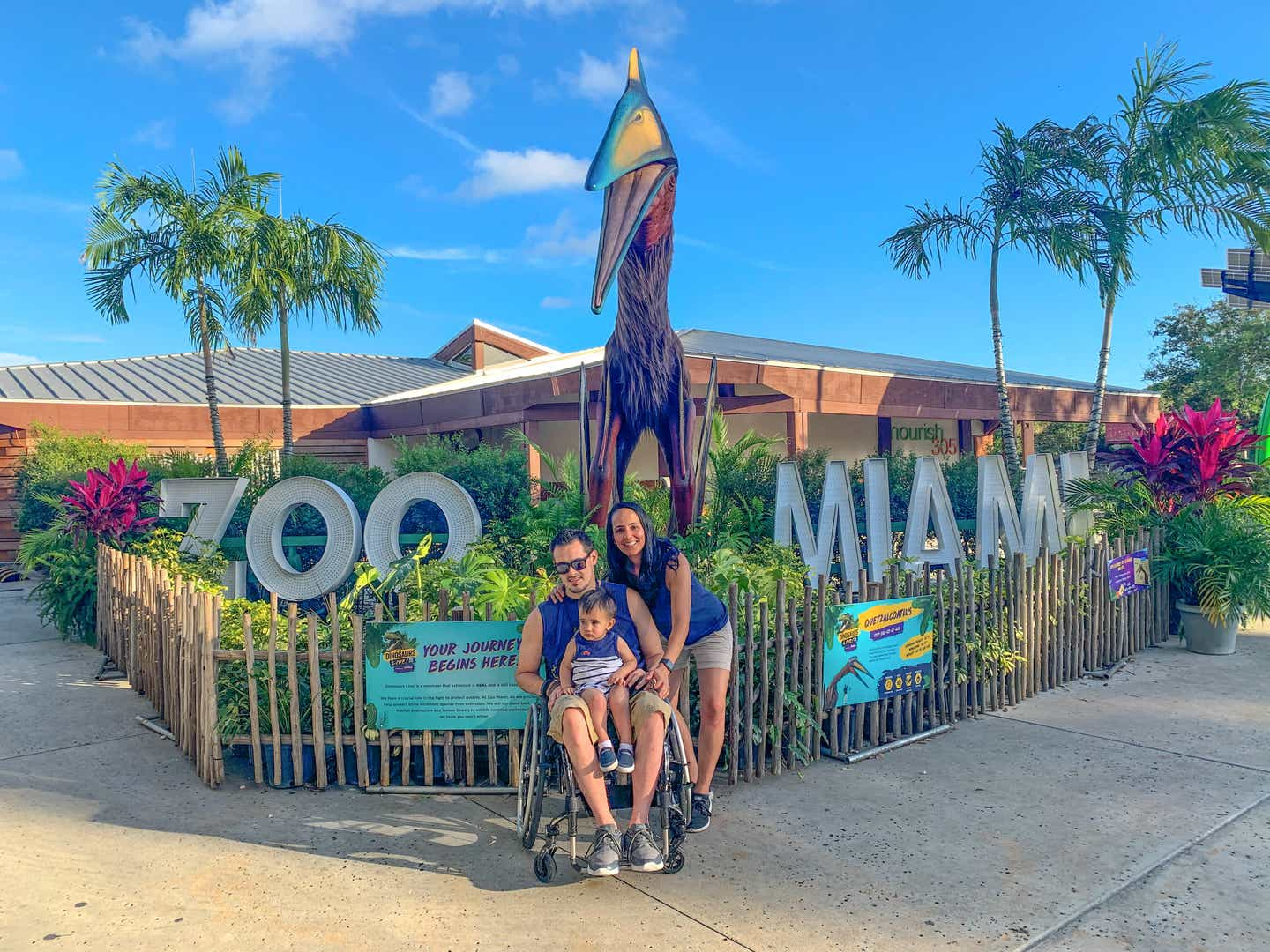Danny and his family in front of the Zoo Miami sign
