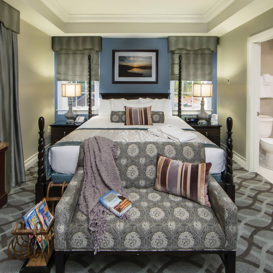 Master bedroom in a Signature Collection villa at Williamsburg Resort