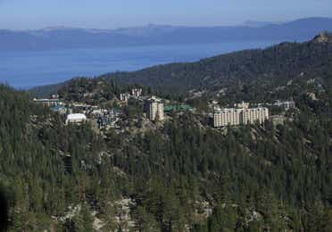 Aerial view of Tahoe Ridge Resort next to Lake Tahoe in the summer