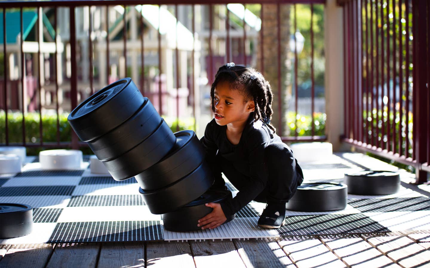 Child playing with life-sized checkers at Fox River Resort in Sheridan, Illinois.