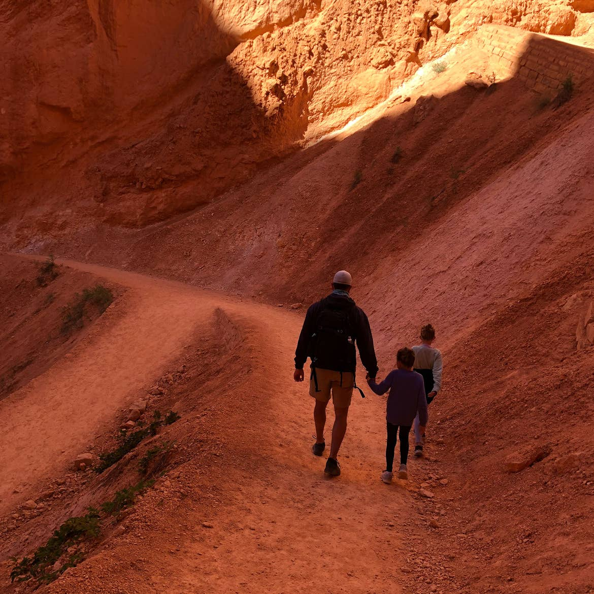 Josh (left) Kyndall and Kyler (right) walk amongst the red rock formation at Bryce Canyon.
