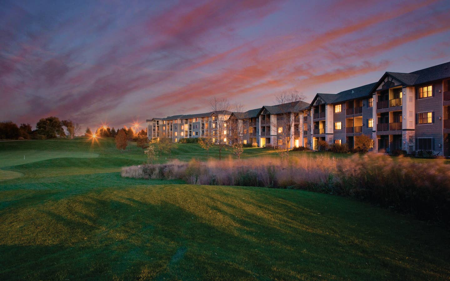View of golf course and property buildings at Lake Geneva Resort
