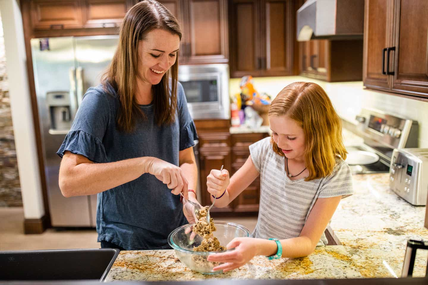 Author Jessica Averett (left) and her daughter (right) bake cookies in our Scottsdale Resort Villa kitchen.